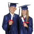 Two Happy Students Holding Degree — Stock Photo