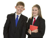 Schoolgirl And Schoolboy Holding Book — Stock Photo