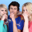 Foto Stock: Portrait Of Happy Three Friends Drinking Champagne