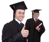 Two graduates with the first showing a thumbs up sign and the se — Stock Photo