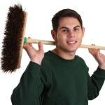 Gardener with a broom — Stock Photo #7535481