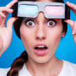 Amazed young woman in 3d glasses — Stock Photo #12553011