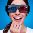 Stock Photo: Cheerful young woman watching 3d film