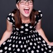 Happy young woman in polka-dot dress — Stock Photo #12553048