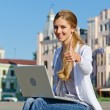 Stock Photo: Student sitting with laptop