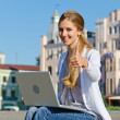 Student sitting with laptop — Stock Photo