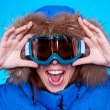 Woman in ski glasses and winter coat — Stockfoto