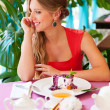 Attractive woman having breakfast in cafe — Stock Photo #13133764