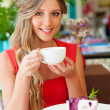 Woman having breakfast at cafe — Stock Photo
