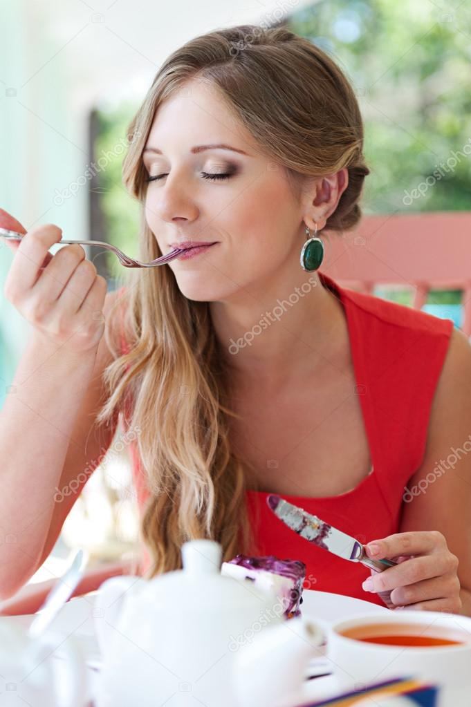 Young female eating dessert with pleasure — Stock Photo #13133801