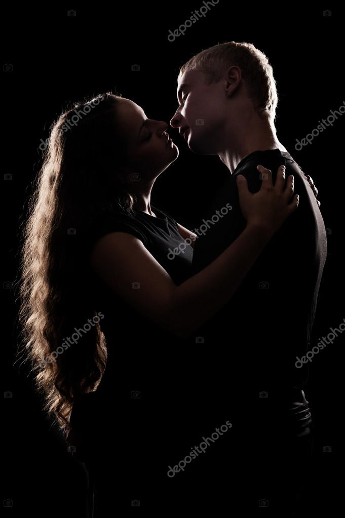 Silhouette of romantic couple over black background — Stock Photo #13133865
