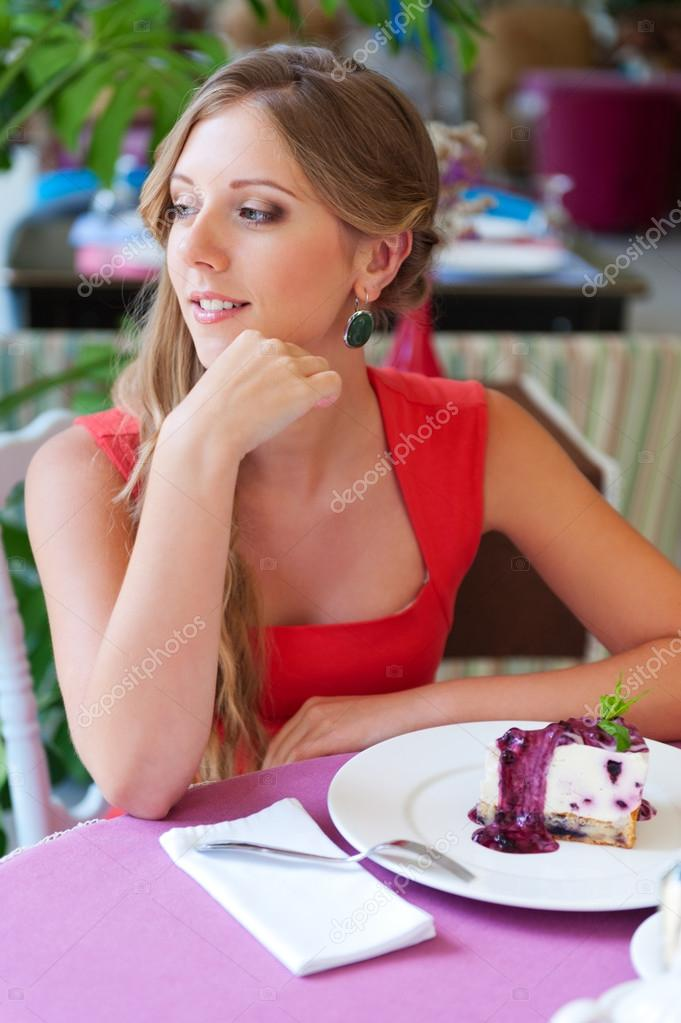 Alluring woman sitting in cafe and resting — Stock Photo #13133963