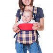Mother holding her baby in the knapsack — Stock Photo #13592163