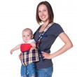 Mother holding her son in the sling — Stock Photo #13592166