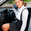 Smiley businesswoman sitting in the car — Stock Photo #13592193