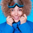 Stock Photo: Smiley skier feeling cold