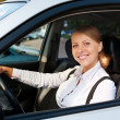 Woman driving the car and smiling — Foto Stock