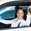 Woman sitting in car and showing the car keys — Stockfoto #13592231