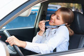 Attractive woman driving the car — Stock Photo