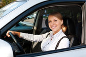 Woman driving the car and smiling — Stock Photo