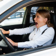 Woman driving the car and honking - Foto de Stock