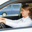 Prosperous businesswomdriving car — Stock Photo #13771857