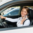 Businesswoman talking on the cellphone and parking - Stok fotoğraf