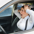 Frightened woman sitting in the car — Stock Photo