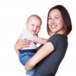 Mother holding in her arms smiley son — Stock Photo #13771918