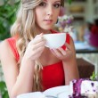 Alluring woman with cup of tea — Stock Photo