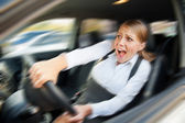 Female driving the car and screaming — Stock Photo