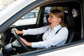 Woman driving the car and honking — Stock Photo