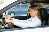 Prosperous businesswoman driving the car — Stock Photo