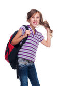Excited girl holding rucksack — Stock Photo