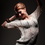 Joyful young woman dancing — Stock Photo #14568373