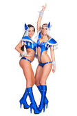 Two alluring go-go dancers in blue costumes — Stock Photo