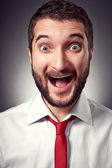 Excited young man with beard — Foto de Stock