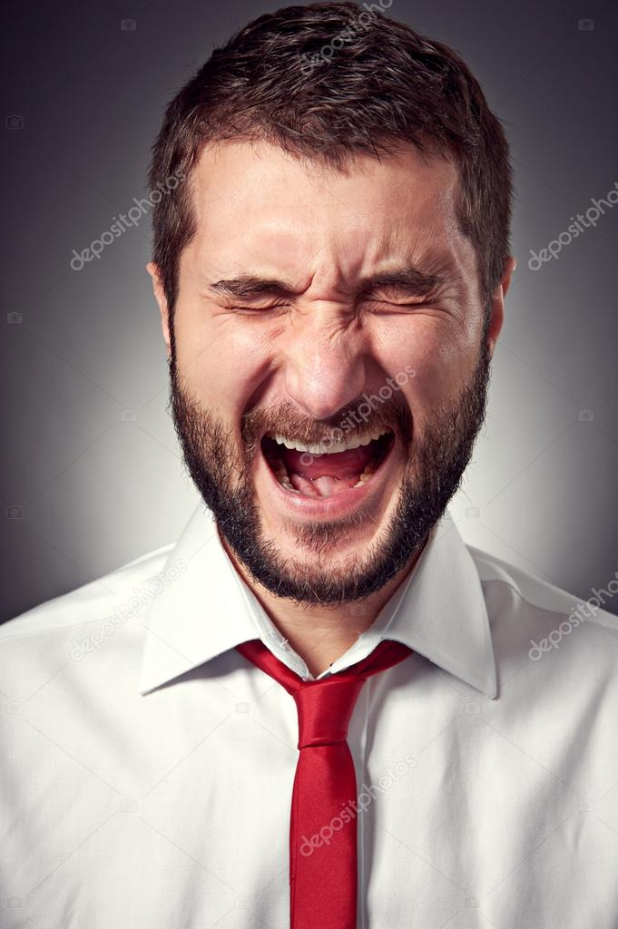 Portrait of screaming man over grey background — Stock Photo #18764969