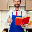 Cook at the kitchen showing thumbs up — Stock Photo