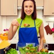 Housewife holding spoon with salad  — Stock Photo