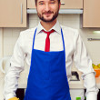 Min blue apron in kitchen — Stock Photo #21672013