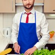Stock Photo: Min formal wear preparing salad
