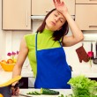 Tired housewife preparing dinner — Stock Photo