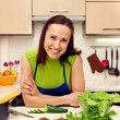 Woman with vegetables in kitchen — Stock Photo #21672059