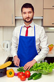 Man in formal wear preparing salad — Stock Photo