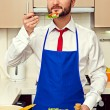 Man eating fresh salad — Stock Photo