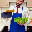 Man holding lettuce and pan with spaghetti — Stock Photo #22065689