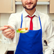 Man holding spoon with salad — Stock Photo #22065693