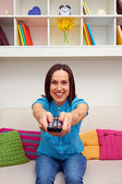 Excited woman watching tv — Stock Photo