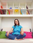 Smiley woman sitting on the sofa — Stock Photo